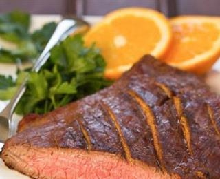 ستيك اللحم بالثوم وصوص البرتقال